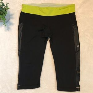 Lululemon cropped tights w/ green waist band S12